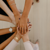 Hands in, teamwork, women working together