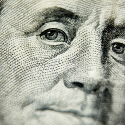 Close up of Benjamin Franklin's face, $100 bill