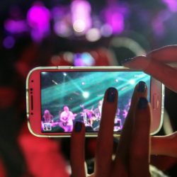 Photograph of cell phone recording concert