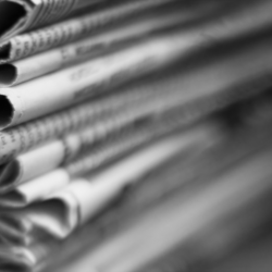 Close up of stack of newspapers