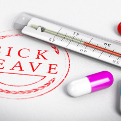 Sick leave for employees, close up of sick leave stamp and thermometer