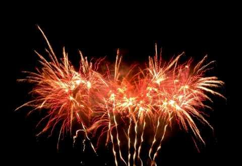 Red streaky fireworks in a black sky