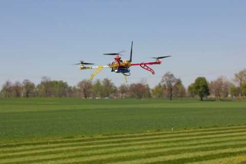 Photograph of drone over farm field