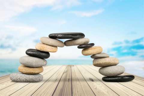 Teamwork image using rocks to make a bridge