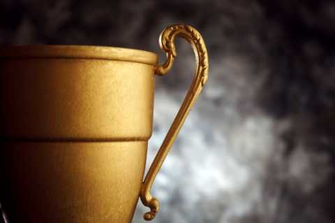 Gold Trophy on dark background