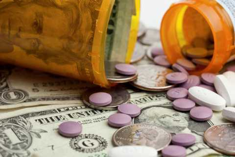 Photograph of prescription bottle with pills and money