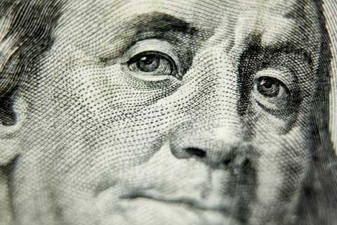 Close up of Benjamin Franklin's face, $100 bill