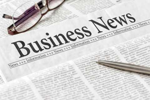 Business News Headline on a newspaper