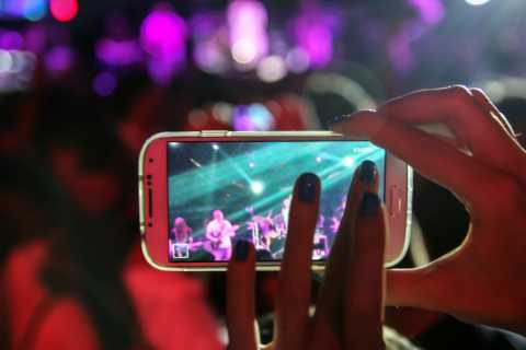 Cell phone camera recording a concert