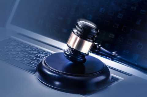 Computer, gavel, criminal justice system
