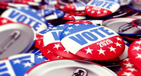 Close-up of stack of voter pins for 2020