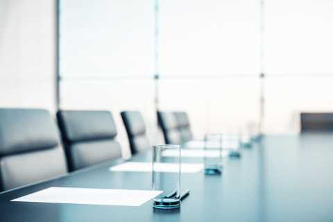 Close up of empty chairs in conference room, board meeting