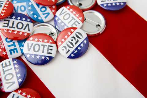 Voter pins on top of American Flag