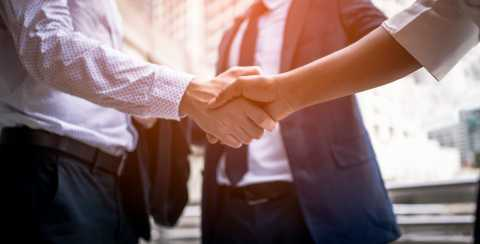 Close-up of shaking hands, networking