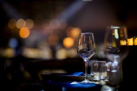 Closeup of table setting at event with blurred background